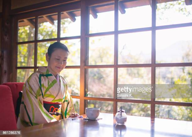 Woman in Kimono at cafe in the morning