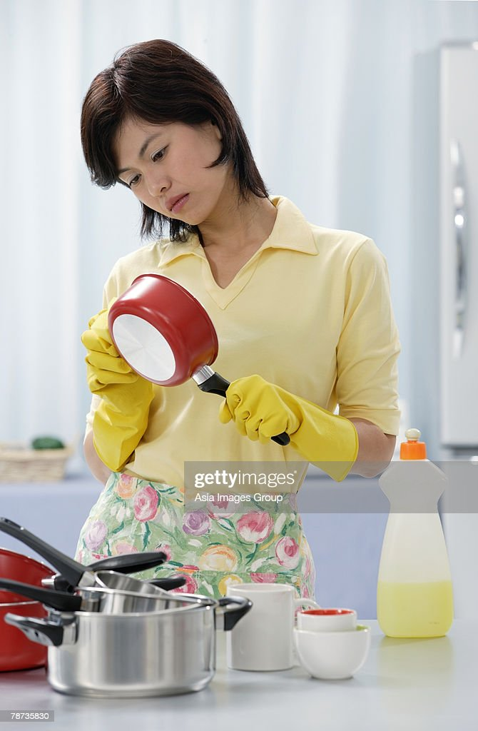 Woman In Kitchen Cleaning Pots And Pans Stock Photo ...