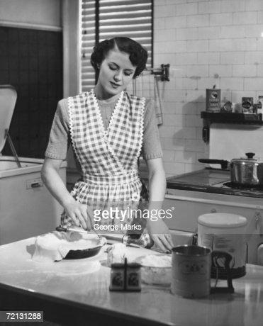 Woman in kitchen making pie (B&W)