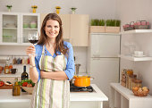 Woman in kitchen.