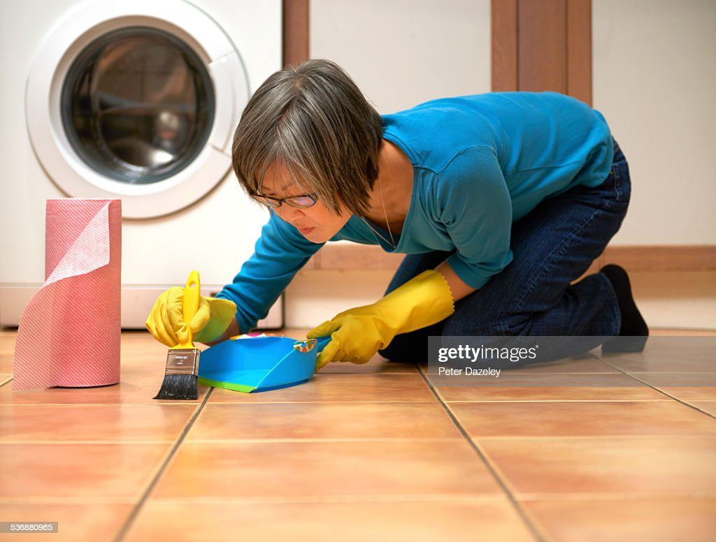 Woman in kitchen with OCD