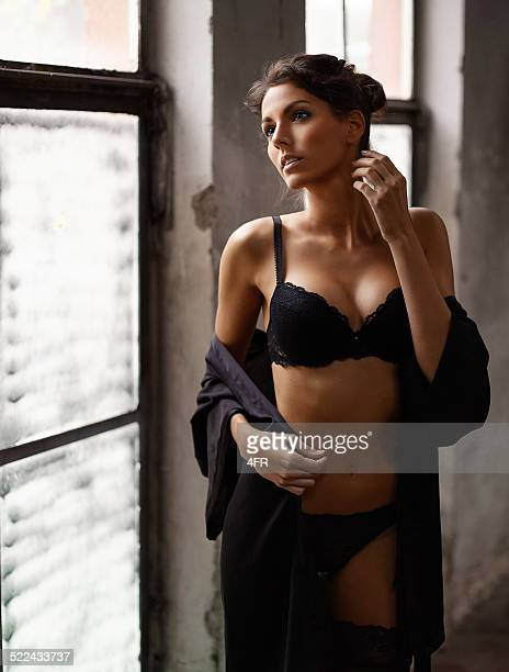 Woman in Lingerie looking out the Window