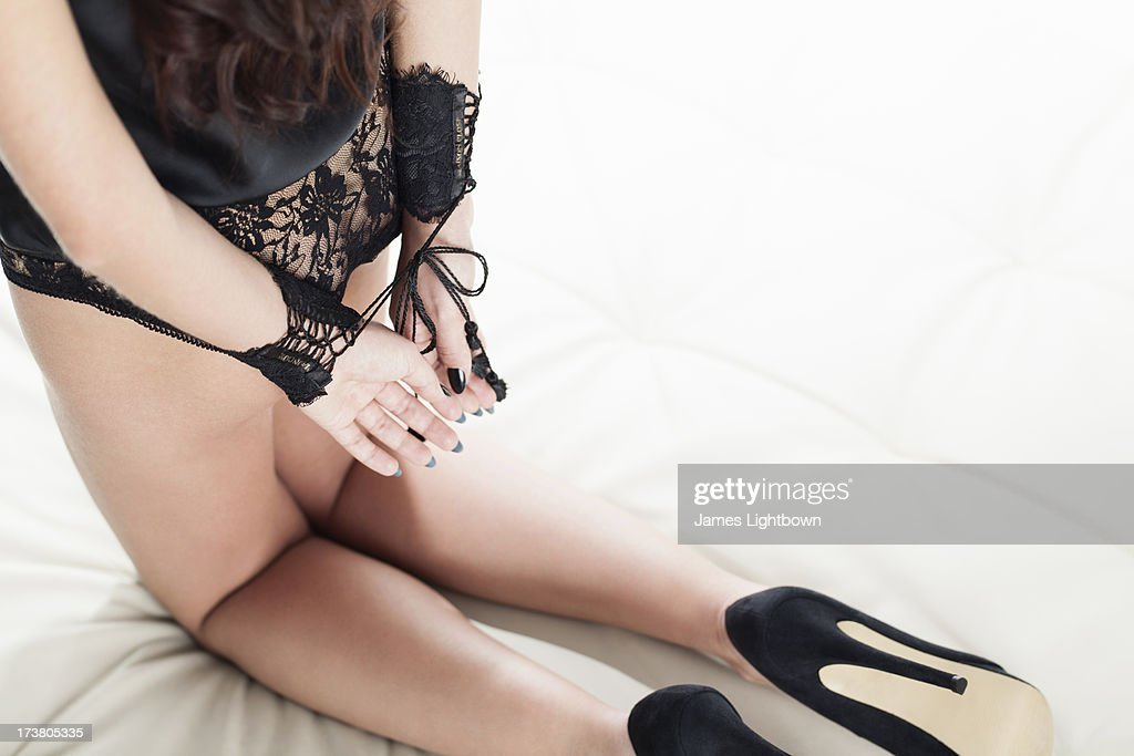 Woman in lingerie with hands tied : Stock Photo