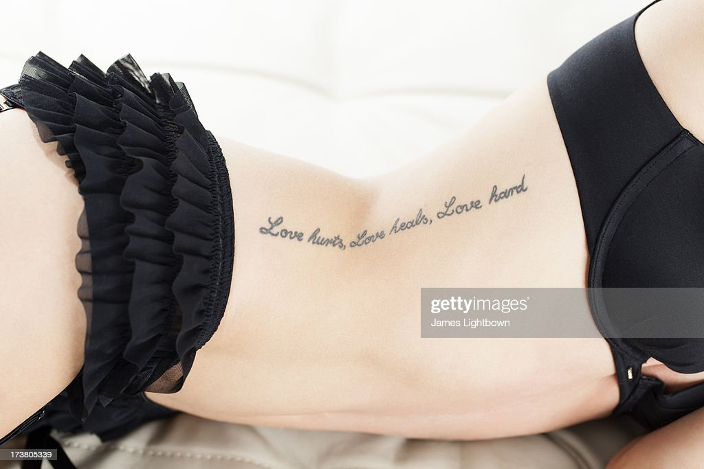 Woman in lingerie with text tattoo : Stock Photo