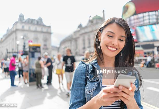 Woman in London using her cell phone