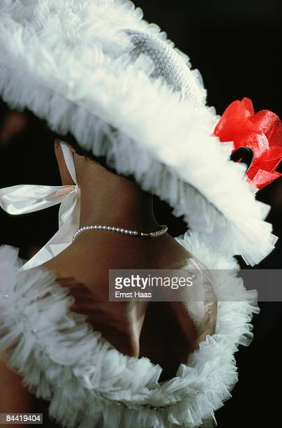 A woman in matching whitefrilled dress and hat for the Mardi Gras in New Orleans February 1978