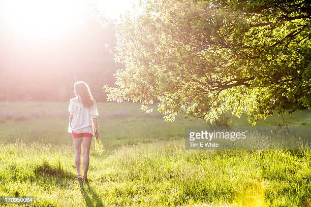 Woman in meadow at sunset