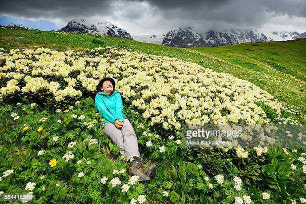 Woman in meadow of rhododendron flowers, Caucasus