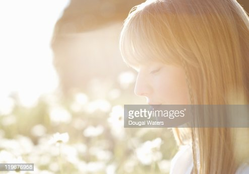 Woman in meadow with eyes closed. : Stock Photo