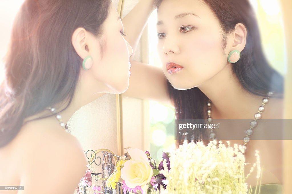 Woman in mirror : Stock Photo