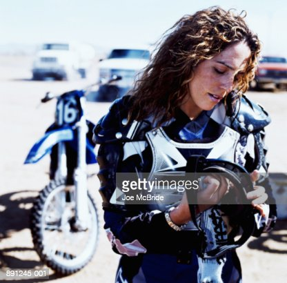 Woman in motocross outfit (cross-processed)