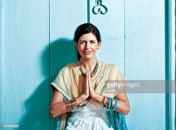 Woman in namaste pose