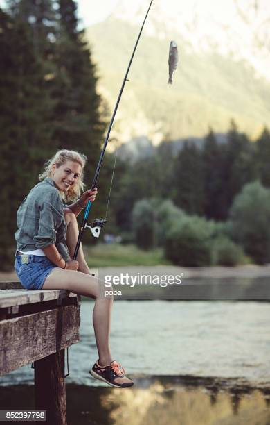 Woman in nature fishing