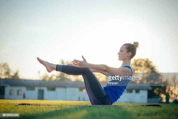 Woman in Navasana Yoga pose