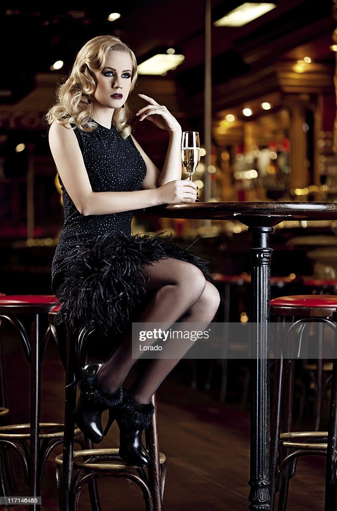 woman in night club with glass of champagne : Stock Photo