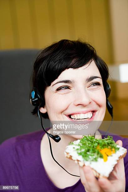 woman in office having a snack