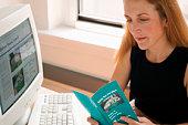 Woman in office reading brochure