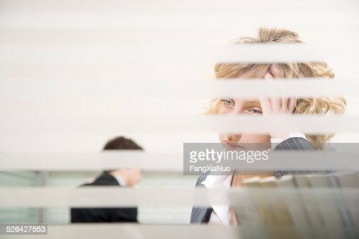 Woman in Office Resting Her Head on Her Hand