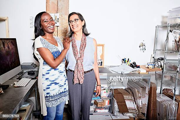 Woman in office side by side smiling