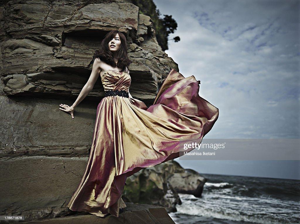 Woman in orange Dress on the beach