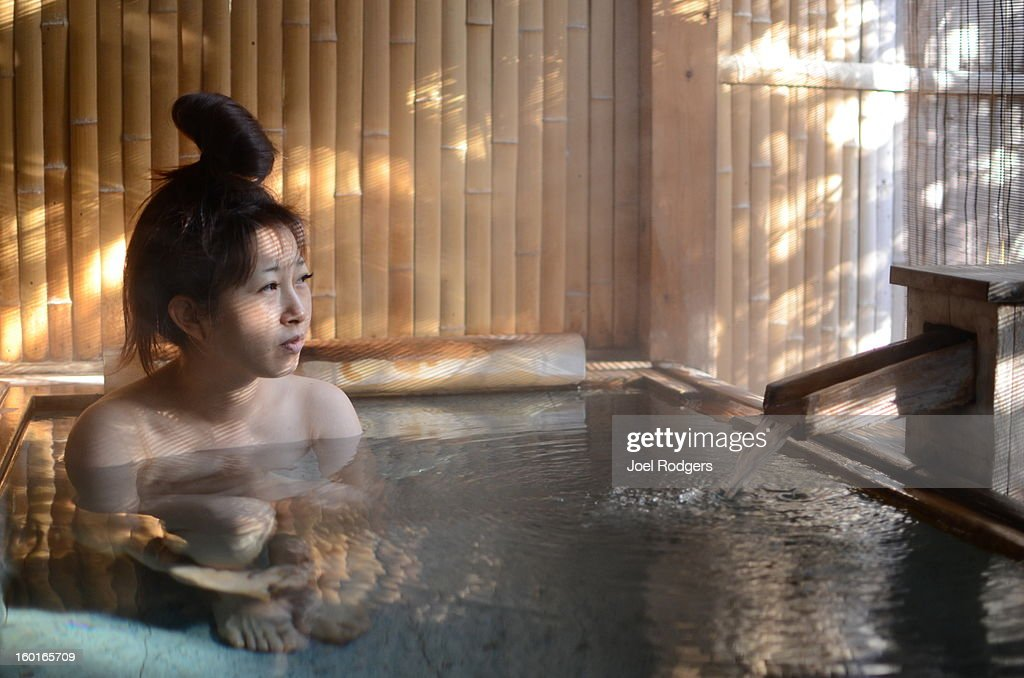Woman in outdoor bath : Stock Photo