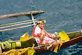 Woman in Outrigger Canoe at Welcoming Ceremony