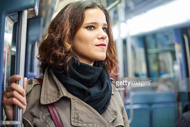 Woman in Paris Metro train.