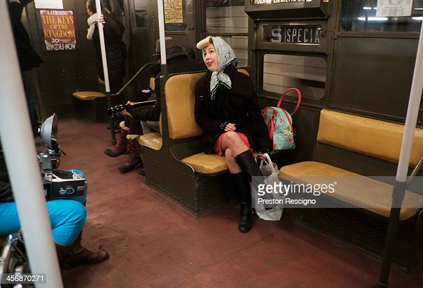 A woman in period costume rides on the Metropolitan Transit Authority 'Nostalgia' vintage subway train on December 15 2013 in New York City The MTA...