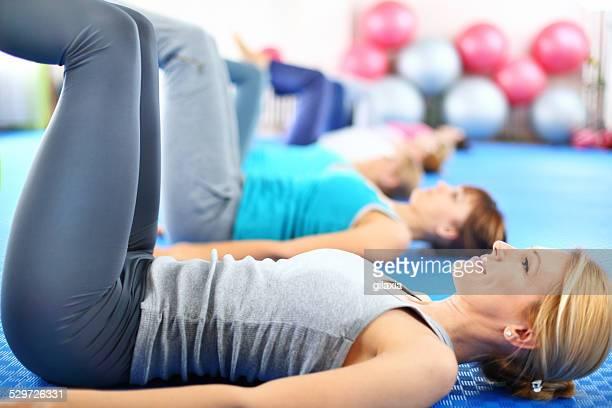 Woman in Pilates class.