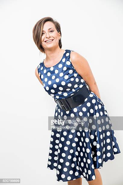 Woman in polka dot dress