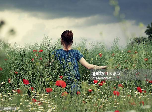 Woman in poppy field
