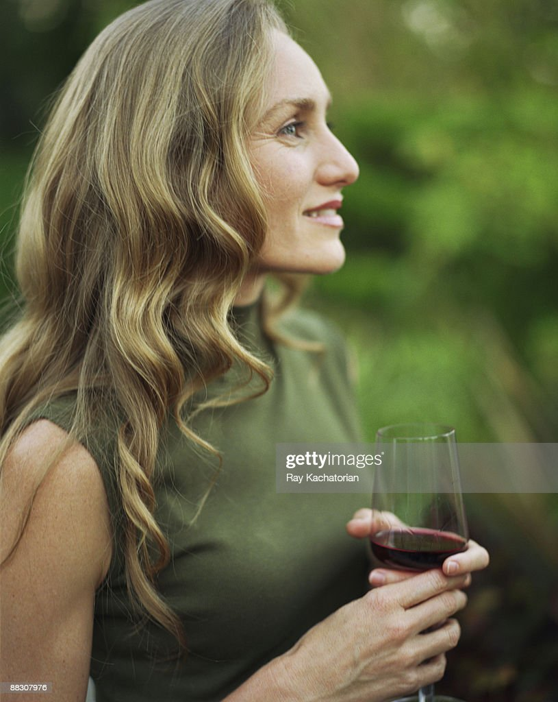 Woman in profile with red wine : Stock Photo