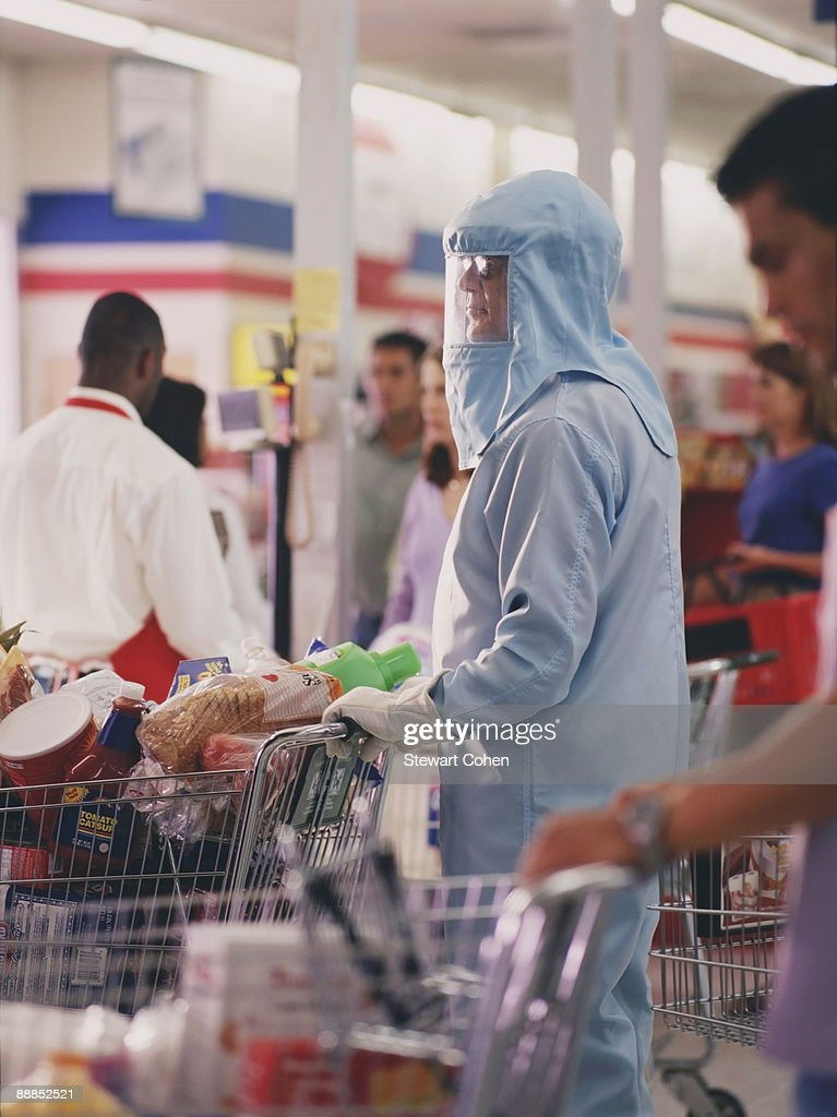 Woman in protective workwear in supermarket : Stock Photo