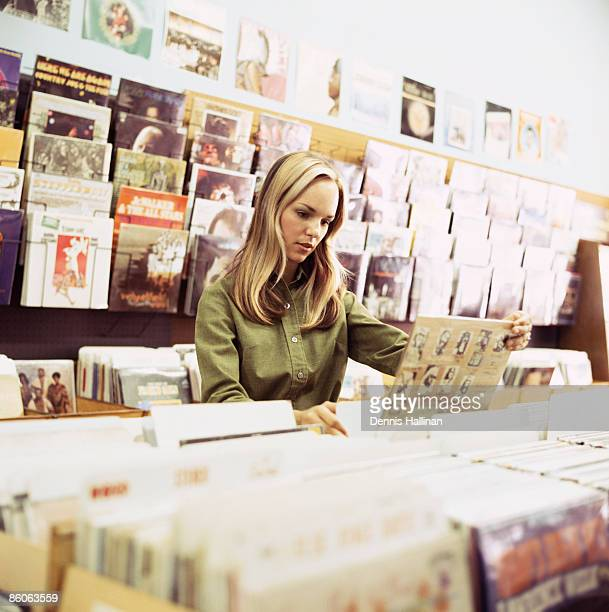 Woman in record store