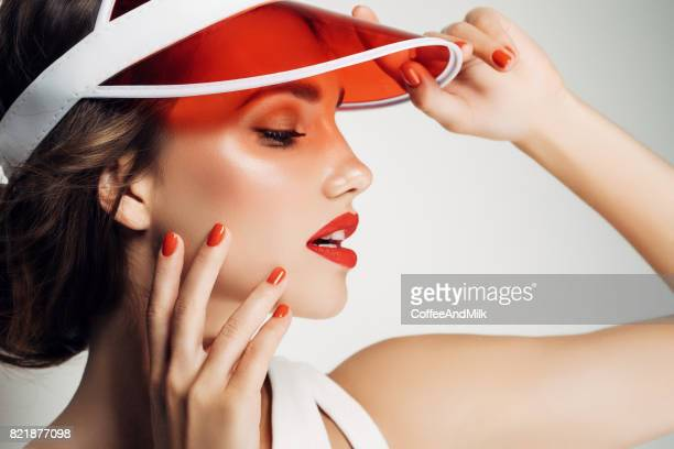 Woman in red cap looking away