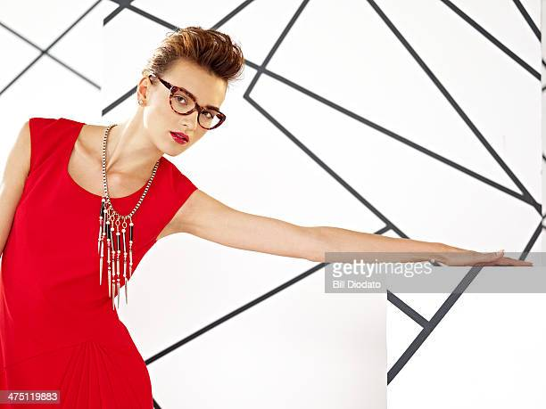 woman in red dress and glasses