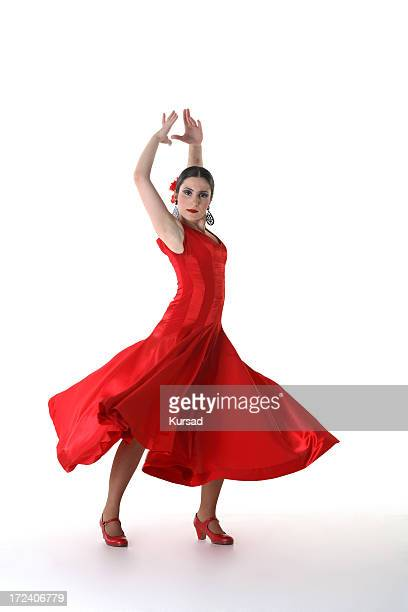 Woman in red dress and shoes in Flamenco dance pose