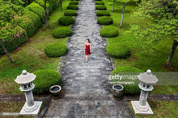 woman in red dress at a temple on Jeju Island