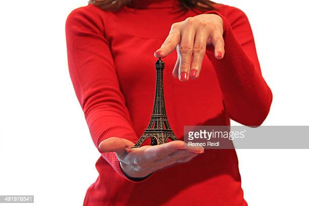 Woman in red dress with an Eiffel tower model