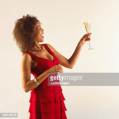 Woman in red dress with glass of wine
