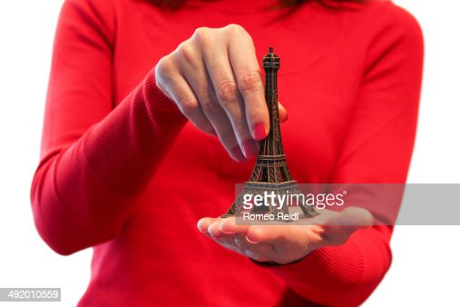 Woman in red eiffel tower in the palm stock photo getty images