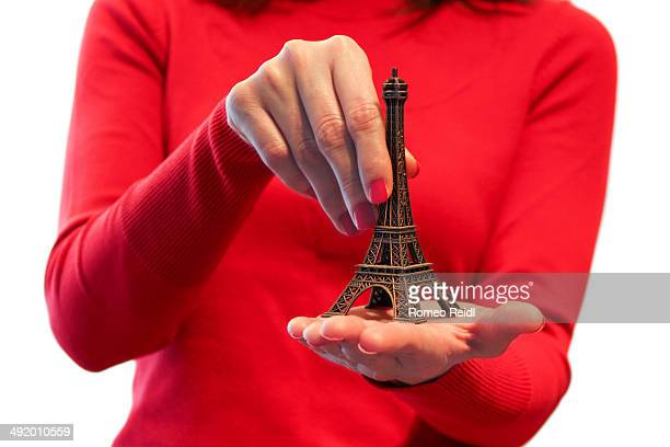 Woman in red - Eiffel tower in the palm