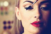 blonde paints eyelashes