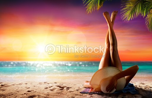 woman in relaxation on tropical beach at sunset ストックフォト