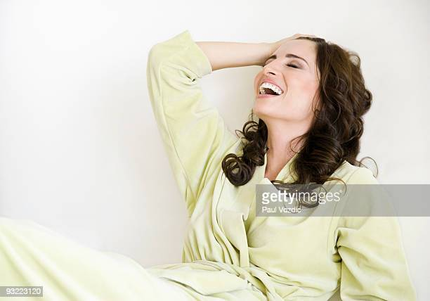 Woman in robe laughing