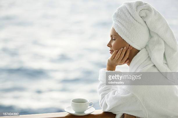 woman in robe with coffee