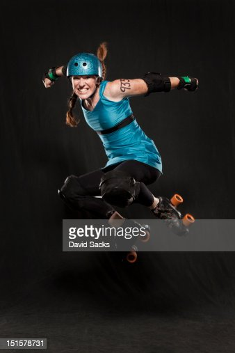 Woman in roller skates jumping : Stock Photo