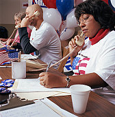 Woman in row of campaign supporters on telephones