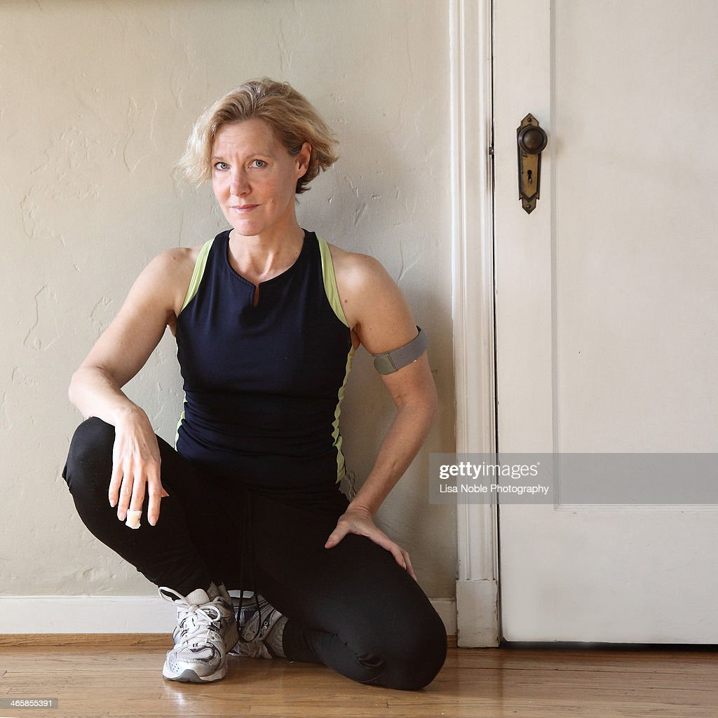 Woman in running/exercise clothes sitting