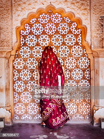 Woman in Sari at Decorated Window